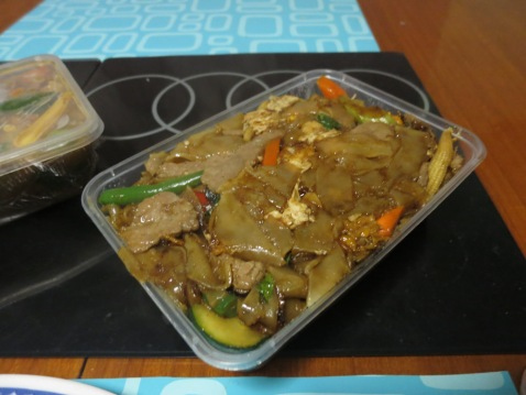 Steaming hot and spicy beef with flat noodles